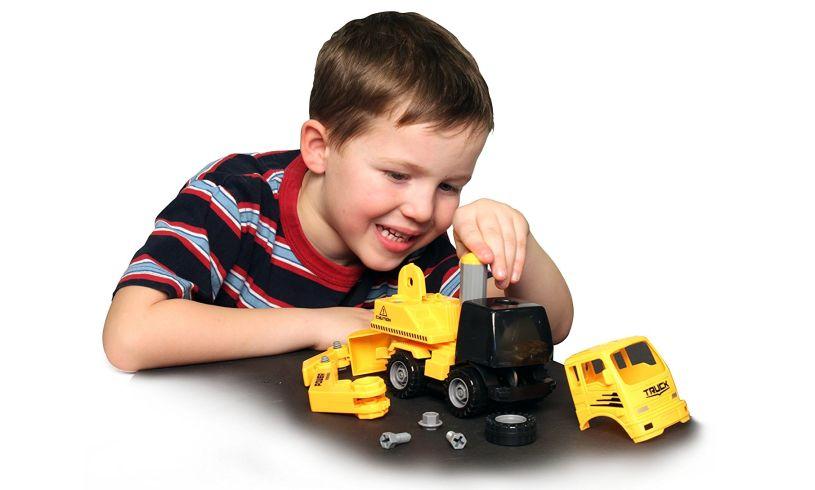 Child constructing his truck