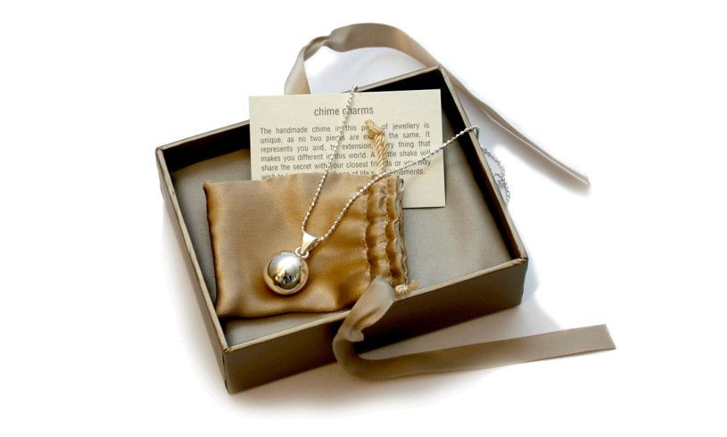box showing chiming ball necklace