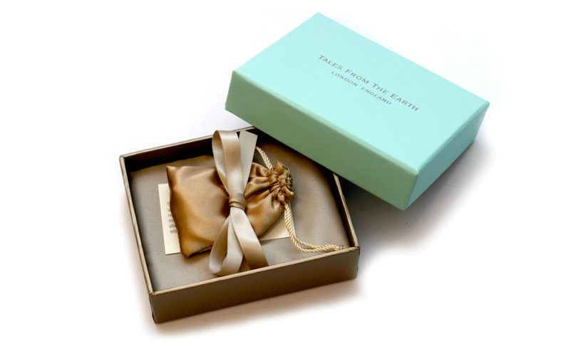 open box with silk bag