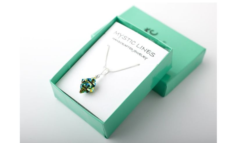 box with aqua green necklace
