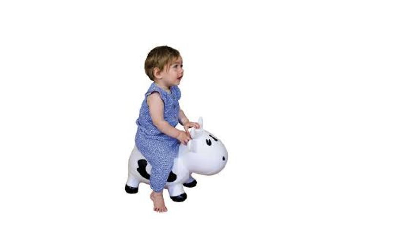 toddler riding bouncy cow