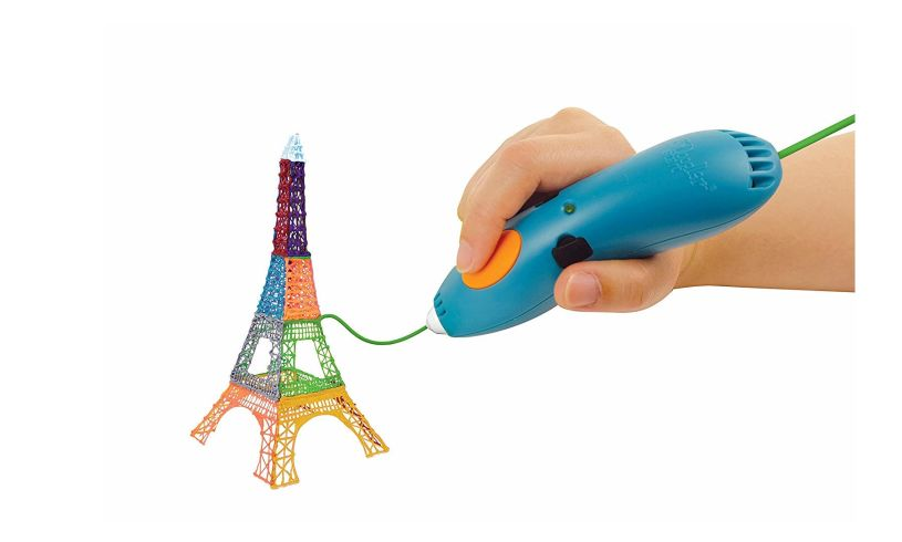 child making eiffel tower with 3d pen