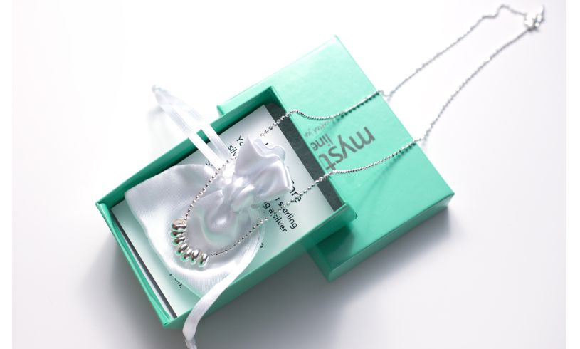 box with lucky seven necklace