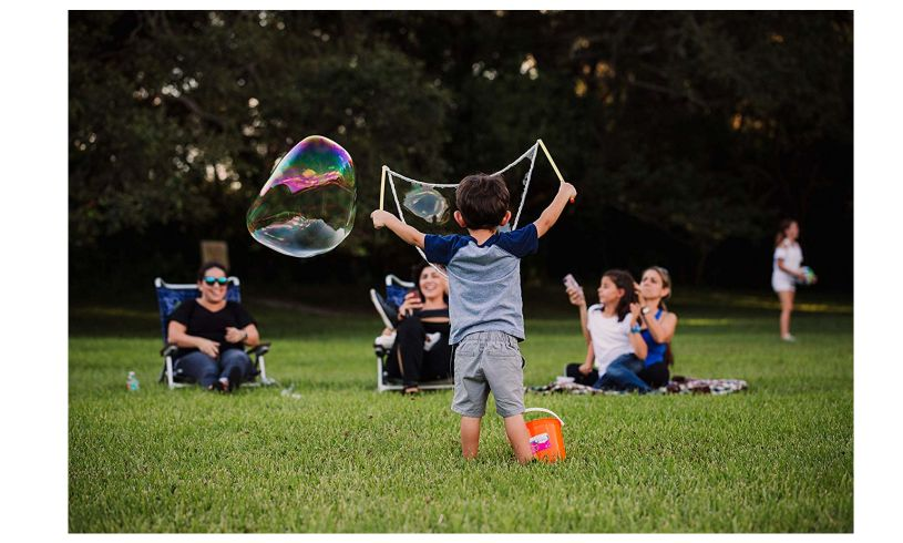 toddler making the giant bubble