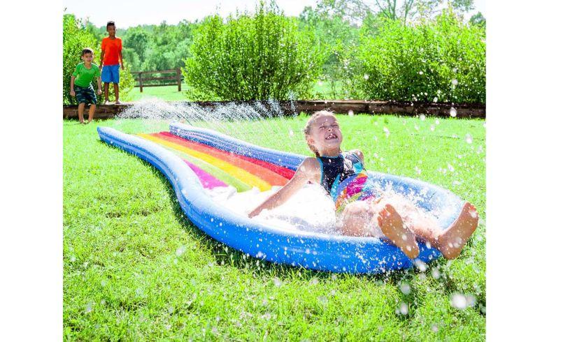 kids splash in rainbow water slide