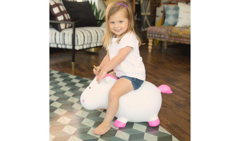 preschooler riding bouncy unicorn
