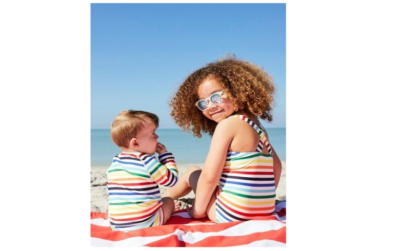 Beach girl wearing Babiator jet setter sunglasses