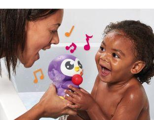Tuneless penguin with little girl Tomy
